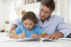Father Helping Son With Homework Stock Photos