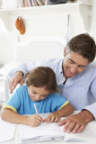 Father Helping Son With Homework royalty free stock photography