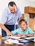 Father helping son to do homework Stock Photography