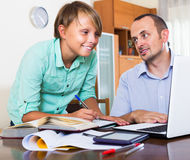 Father helping son to do homework Royalty Free Stock Images