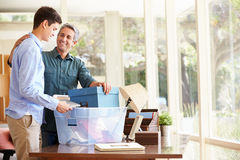 Father Helping Teenage Son Pack For College Royalty Free Stock Photos