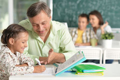 Father helps daughter with homework Stock Images