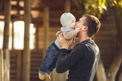 Father and her child enjoy the summer in the park. Outdoors. Stock Photos