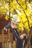 Father and her child enjoy the summer in the park. Outdoors. Royalty Free Stock Photo