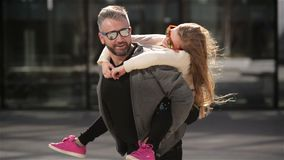 Father with her cute daughter having fun outdoors. Fathers day mood. HD, happy family, spending time together stock video footage