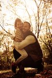 Father and her daughter enjoying in park and hugging. Happy father and her daughter enjoying in park and hugging royalty free stock image
