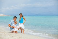 Father with her two kids on beach vacation Royalty Free Stock Images