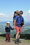 Father hiking with children Royalty Free Stock Photo