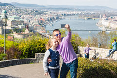 Father and his adorable daughter taking selfie Stock Photos