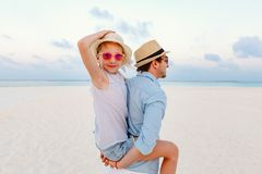 Father and daughter at beach. Father and his adorable little daughter at beach Stock Photo