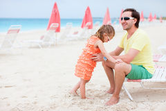 Father and daughter at resort beach Royalty Free Stock Photos