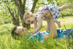 A father with his baby outdoor at park royalty free stock photo
