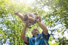 A father with his baby outdoor at park stock image