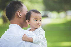 Father with his baby in park. Royalty Free Stock Images