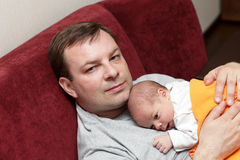 Father with his baby. On the sofa Royalty Free Stock Photo