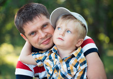 Father and his baby son having fun in the park outdoor. Happy father and his baby son having fun in the park outdoor Stock Photos