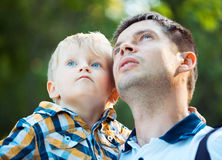 Father and his baby son having fun in the park outdoor. Happy father and his baby son having fun in the park outdoor stock images