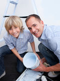 Father and his boy smiling at the camera Royalty Free Stock Photos