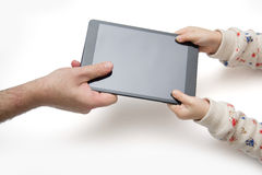 Father and his child can not share the tablet. Stock Image