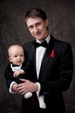 Father and his child in formal dress Royalty Free Stock Photos