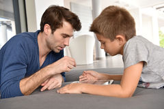 Father and his child playing with tablet Royalty Free Stock Image