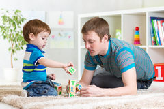 Father with his child son play together Royalty Free Stock Image