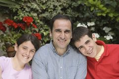 Father with his children. Father with teenager son and daughter Royalty Free Stock Photos