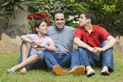 Father with his children. Father with teenager son and daughter Stock Photo