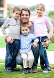 Father with his children Stock Photos