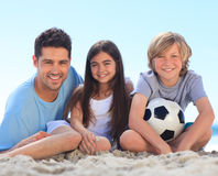 Father and his children with a ball Royalty Free Stock Photo