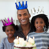 Father with his children celebrating a birthday. Smiling father with his children celebrating a birthday at home Royalty Free Stock Photography