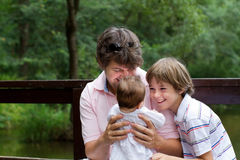 Father with his children in a park Royalty Free Stock Image