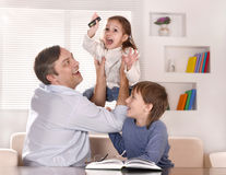 Father and his children playing Royalty Free Stock Photography