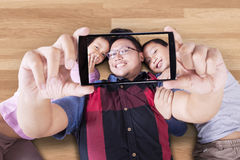 Father and his children taking selfie Stock Images