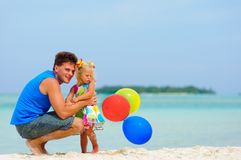 Father and his cute daughter on exotic beach Stock Photos