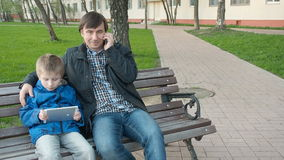Father and his cute young son in the park stock footage