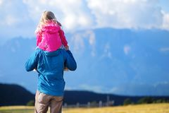 Father and his daughter admiring a view of stunning rocky Dolomites mountains of South Tyrol Royalty Free Stock Image