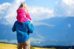 Father and his daughter admiring a view of stunning rocky Dolomites mountains of South Tyrol province of Italy Stock Photos