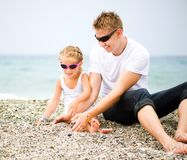 Father and his daughter on the beach Stock Photo