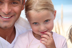 Father and his daughter on beach. Royalty Free Stock Photography