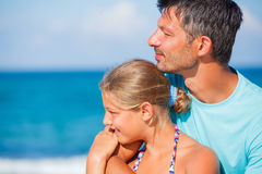 Father and his daughter at beach Stock Images