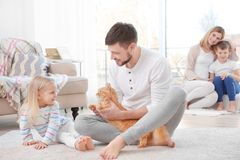 Father with his daughter and cat. At home Royalty Free Stock Images