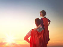 Father and his daughter. Happy loving family. Father and his daughter child girl playing outdoors. Daddy and his child girl in an Superhero's costumes. Concept Royalty Free Stock Image