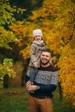 Father with his daughter has fun and holds her on his shoulders royalty free stock images