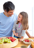 Father and his daughter having breakfast Royalty Free Stock Photo