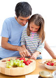 Father and his daughter having breakfast Stock Images