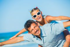 Father and his daughter having fun on beach Royalty Free Stock Photography