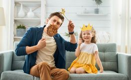 Father and his daughter with a paper accessories stock photos