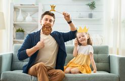 Father and his daughter with a paper accessories stock images