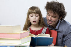 father with his daughter reading book Stock Photos